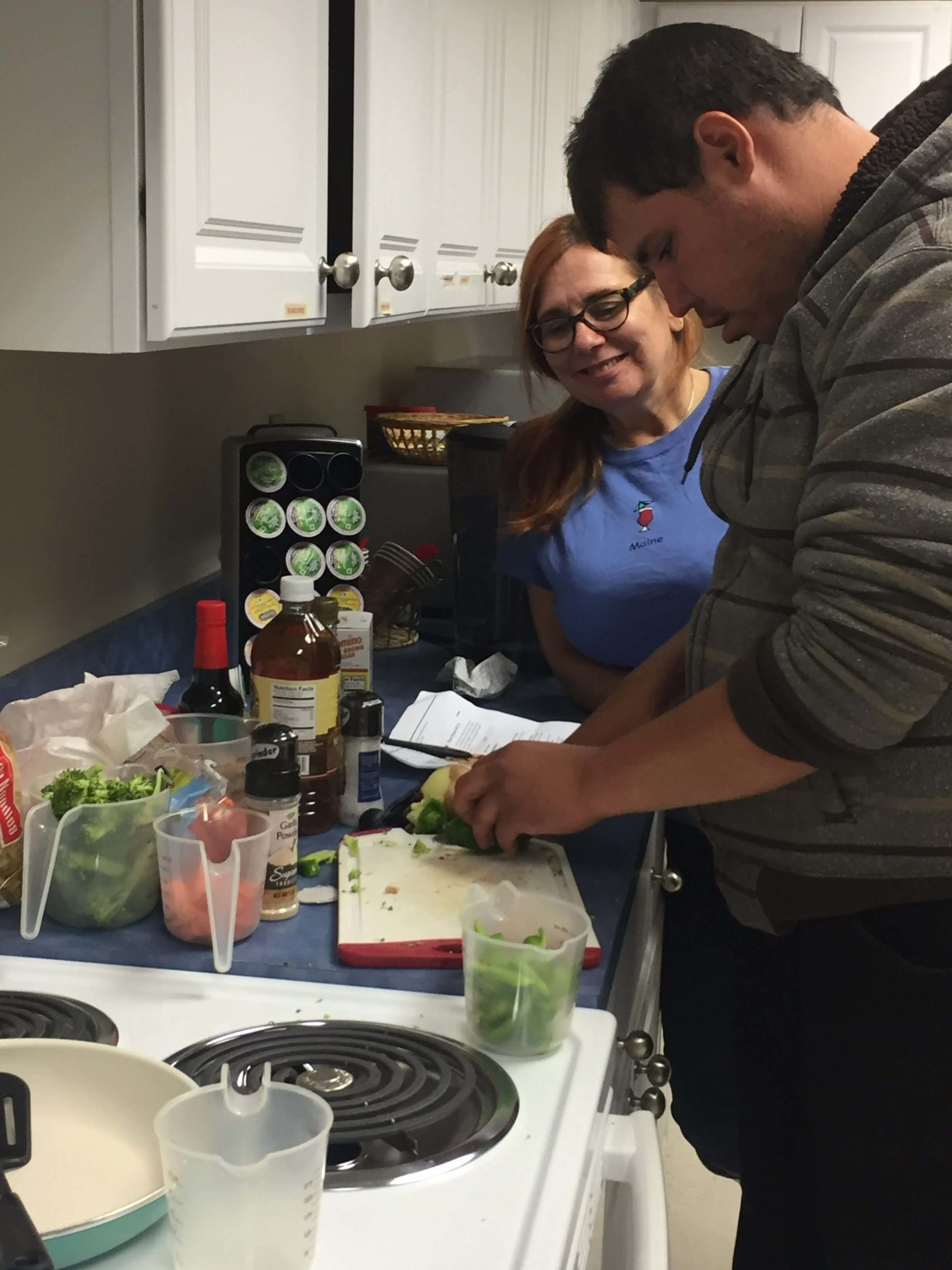 Thrive participants learning cooking skills