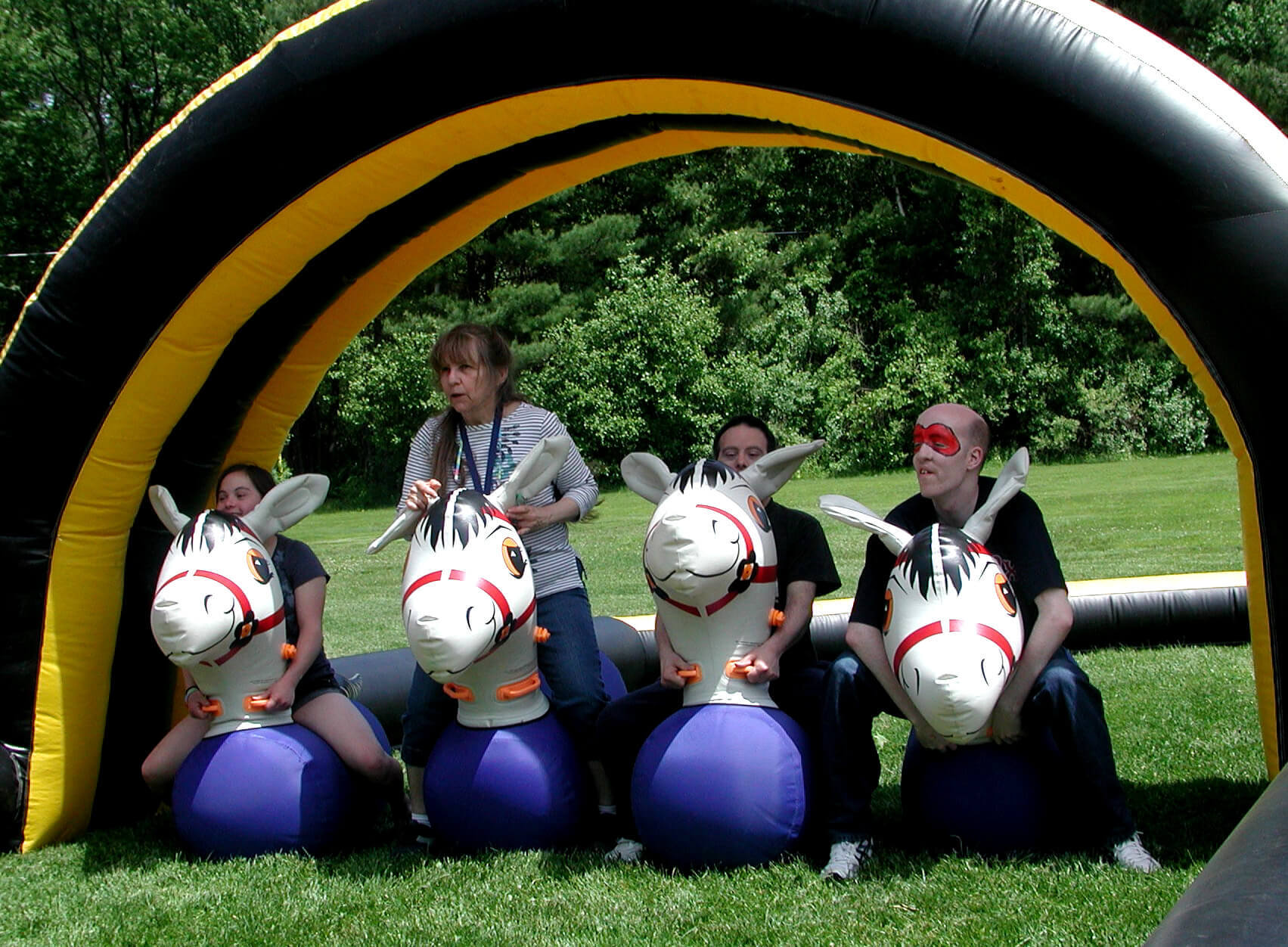 Participants riding on inflatable horses
