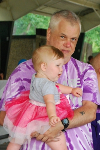 Thrive participant holding baby at FunFest event