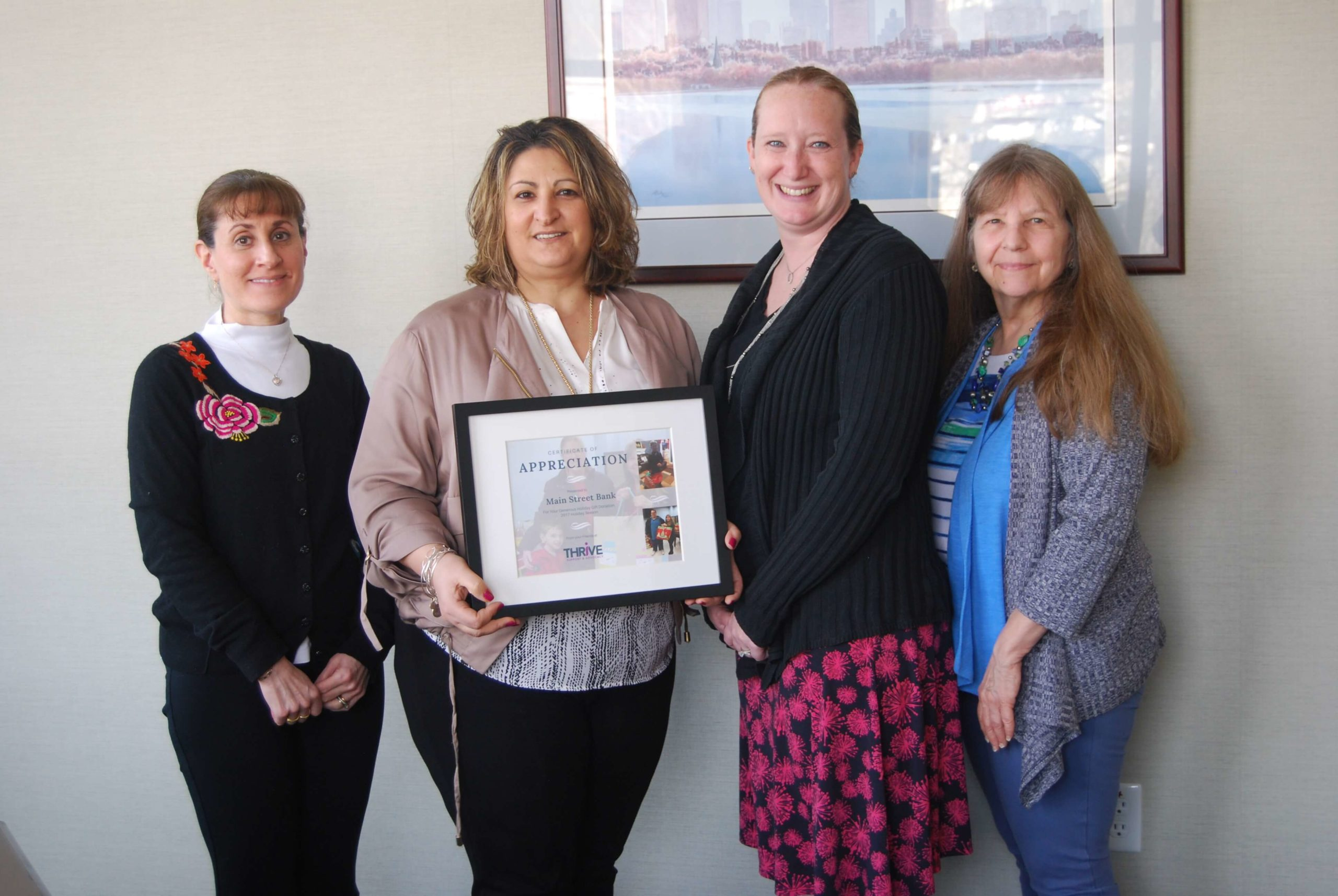 Thrive presentation of appreciation certificate for holiday gift drive participation