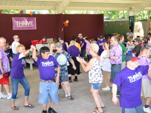 Thrive participants dancing at summer Funfest