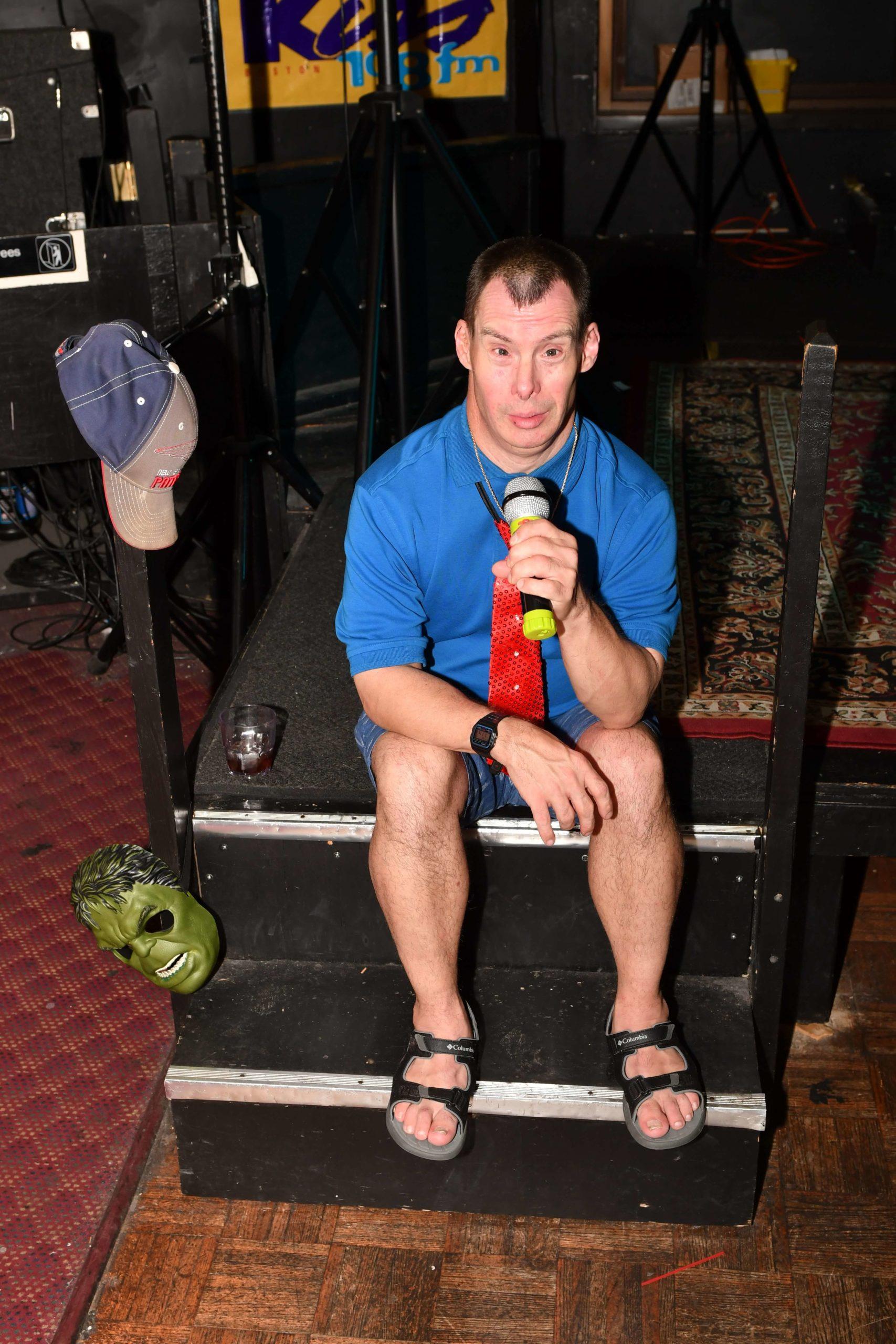 thrive participant doing karaoke