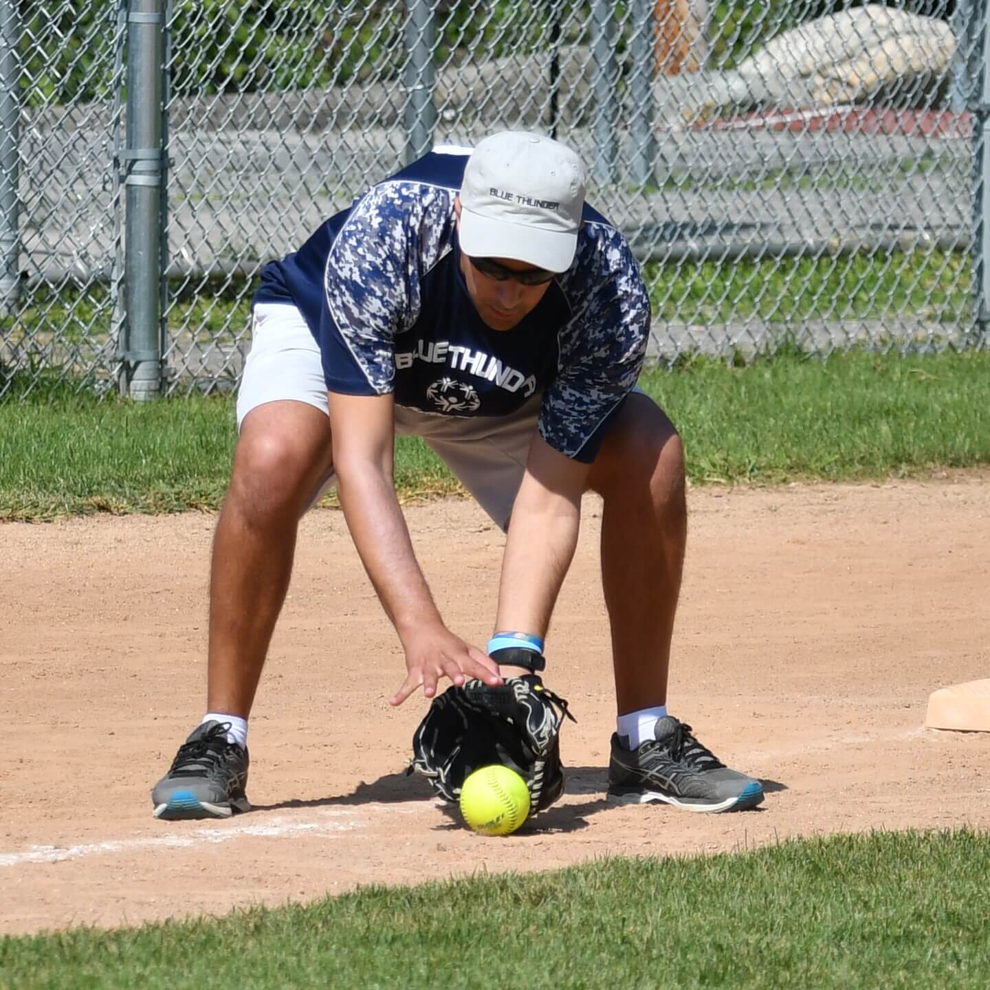 Thrive Softball playing stopping ground ball