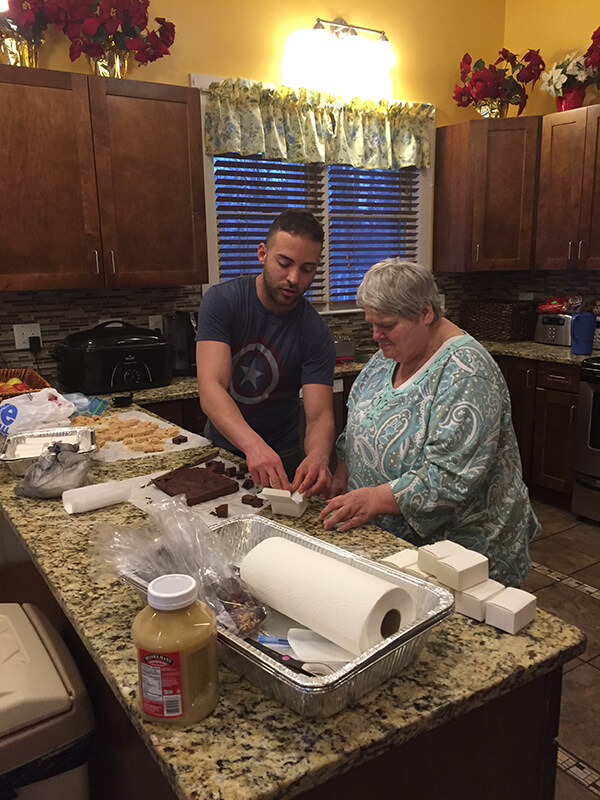 Two people making fudge at a Thrive residence
