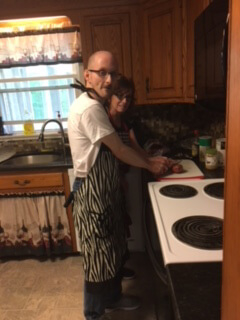 Two people cooking at a Thrive residence