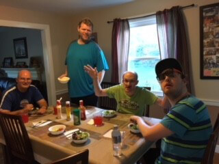 A group of people having dinner at a Thrive residence