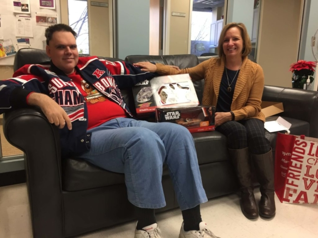 Thrive participant receiving holiday gifts from local company
