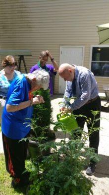 Barri and Jimmy gardening