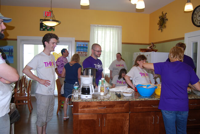 Volunteers and residents gather for lunch