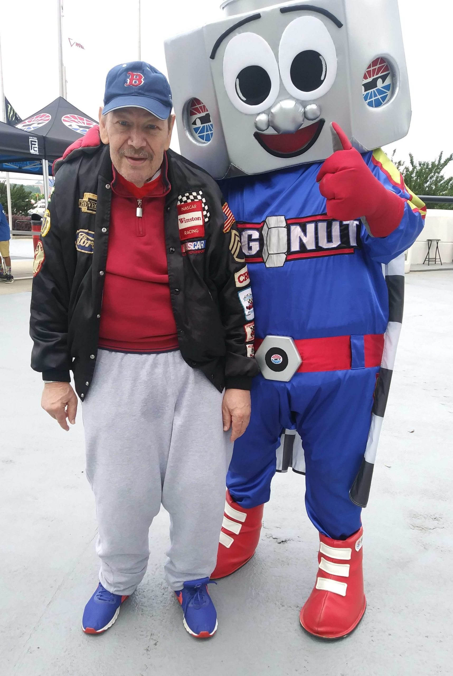 Thrive participants at race track with mascot
