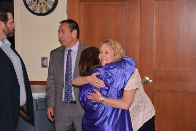 LEAD Graduation Ceremony graduate hugging Thrive staff member
