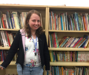 Nicole in the library at her day program.