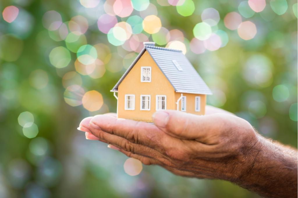 hand holding model home