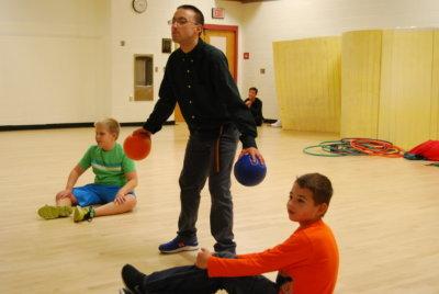 boy holding two balls