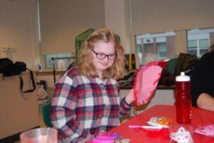 Participant making a valentine