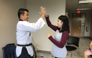 High five from the martial arts teacher to the student
