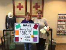 Amy Rieth presenting fundraising check to staff member at American Red Cross in Worcester Massachusetts to aid victims of Hurricane Dorian.